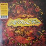 Artifacts ‎/ Between A Rock And A Hard Place